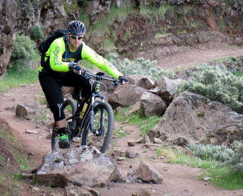 mountain biking Gran Canaria Daniel riding a rocky section