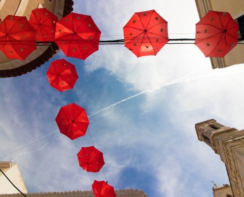 mountain biking Menorca red umbrellas