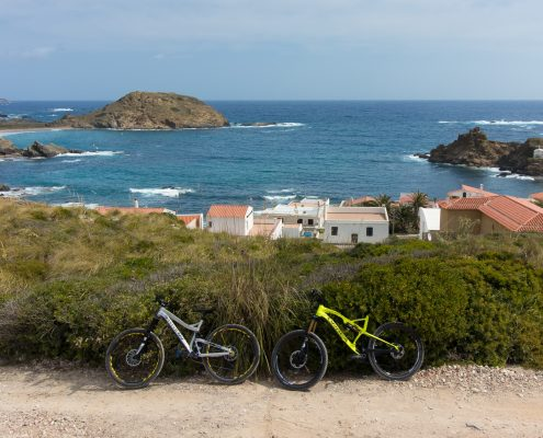 mountain biking Menorca bikes in front of sea coast panorama
